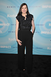 Geena donned a black ruffle blouse with her high-waisted pants for the Lucy Awards in Beverly Hills.