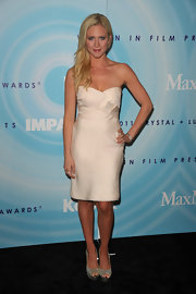 Brittany Snow gave her elegant white cocktail dress a girlish finish with sparkly silver peep-toes.