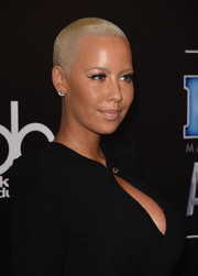 Amber Rose accessorized with classic diamond studs.
