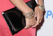 Adding major bling to her look, Eva Mendes showed off a sparkling cluster of gold bangles.