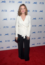 Emily Deschanel kept it modest in a long-sleeve white wrap top during PETA's 35th anniversary party.