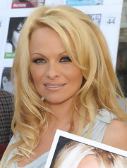 Pamela Anderson wore her hair in softly tousled waves and curls at an event for PETA.