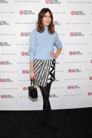 Alexa Chung infused some elegance into her casual look with a boxy black snakeskin purse.