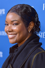 Gabrielle Union sported a slicked-down wavy 'do at the Incredible Women Gala.