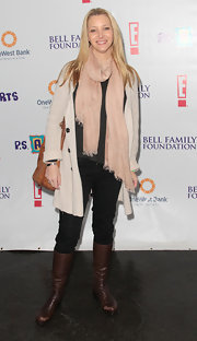 Lisa Kudrow looked ready for cold weather in layers of clothing and knee-high boots.