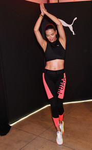Adriana Lima flaunted her abs in a black crop-top at the launch of the new Puma LQD CELL Shatter Shoe.