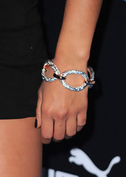 A chunky chain-link bracelet is a subtle touch that will give o=your look instant flair.