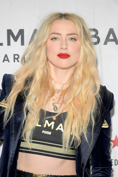 Amber Heard made her pout pop with a swipe of red lipstick.