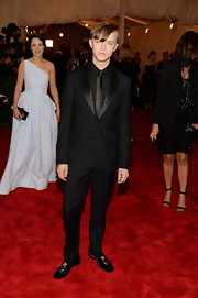 Dane DeHaan chose a solid black suit with a matching black button down and tie for his punk-inspired look at the Met Gala.