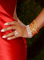 La La Anthony piled on the bling when she attended the Met Gala, wearing layers of gold and diamond bracelets.