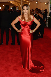 La La Anthony kept her red carpet look at the 2013 Met Gala sleek and classic with this red satin gown.