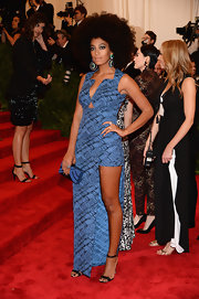Solange Knowles rocked this blue and black patterned dress that featured a triangular cutout under the bodice and a leg-bearing slit.