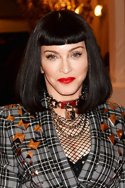 Madge rocked a blood red lip color on the carpet of the Met Gala.