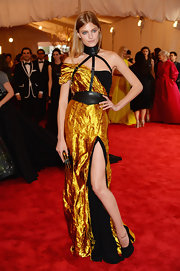 Constance Jablonski rocked this vibrant gold dress with leather neck detailing at the 2013 Met Gala.