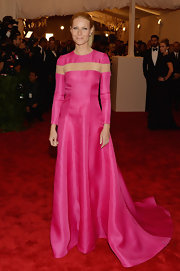 Gwyneth Paltrow chose a solid pink gown with a nude inset across the chest and shoulders for her look at the 2013 Met Gala.