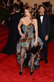 Christina Ricci showed of her punk style at the 2013 Met Gala with this strapless plaid dress that featured a fishtail skirt.