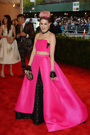 Julie Macklowe took the punk look to heart at the 2013 Met Gala, where she wore this hot pink two-piece evening gown with a strapless crop top and a full skirt with a black polka dot underlay.