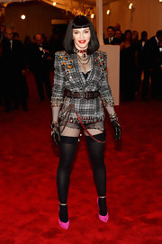 Madonna sported only a look that Madonna could with this gray plaid blazer paired with thigh-high socks, chains, and a studded belt.
