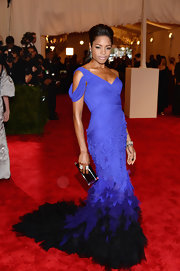 Naomie Harris' elegant mermaid gown at the 2013 Met Gala had a stunning ombre feathered train and draped shoulders.