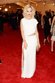 Rita Ora chose this sleek white column-style dress with an asymmetrical top and cool cutout waist.