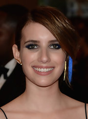 Emma Roberts chose a pinned 'do to show off her blue hair stripe at the Met Gala.