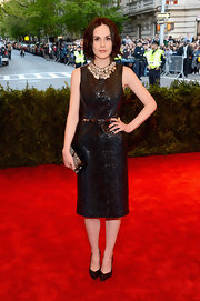 Michelle Dockery's LBD has a bit of edge to it with a croc-embossed texture.