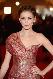 Nora Zehetner chose a berry red lip to bring out the gold and red in her dress.