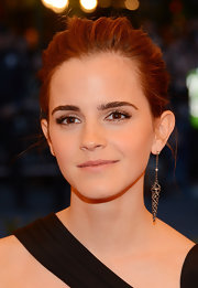 In keeping with the punk theme, Emma Watson accessorized with a single dangling dart earring.