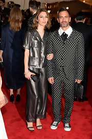 To match the famed fashion designer who accompanied her, Sofia Coppola chose a pair of plaid silk pajamas.