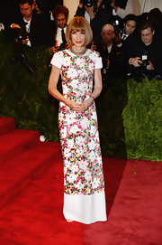 Anna Wintour looked sleek and classy in this floral-print floor-length dress, which she wore to the 2013 Met Gala.