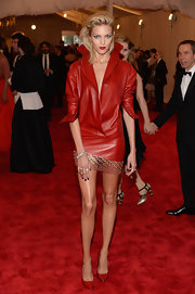 Anja Rubik chose a blood red leather dress with a high standing collar and a metallic disc-embroidered hem for her look at the 2013 Met Gala.