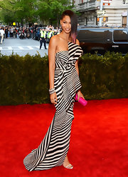 Chanel Iman rocked a black-and-white striped strapless gown for her rocker chick look at the Met Gala.