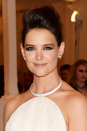 To give her look a more punk-inspired touch, Katie Holmes rocked this teased pompadour.