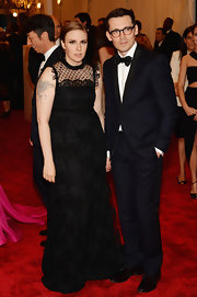 Lena Dunham looked chic and stylish in this black lace sleeveless gown that featured a polka-dot neckline.