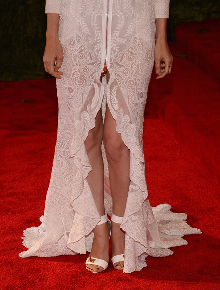 Rooney Mara attended the 2013 Met Gala wearing white Givenchy sandals with gold hardware.