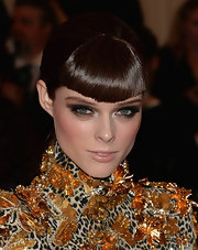 Coco Rocha's look was topped off with this super sleek ponytail and  blunt bangs.