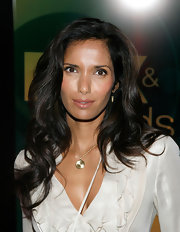 Padma Lakshmi wore her hair long and wavy on a visit to FOX Studios. To try Lakshmi's look at home, curl two-inch sections of hair with a large-barreled curling iron. To finish, tousle curls with fingers and mist with a sheer hold hairspray.