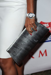 Eva la Rue added a little glam to her look with a silver hard case clutch.