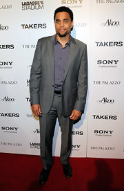 Michael Ealy paired her button down shirt with a sleek grey suit.