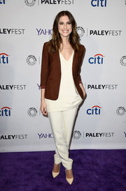 Allison Williams teamed a brown blazer with a white V-neck top and a pair of slacks for the Paleyfest LA 'Girls' event.