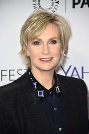 Jane Lynch attended PaleyFest LA wearing this trendy razor cut.