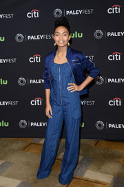 Yara Shahidi topped off her jumpsuit with a blue zip-up jacket by Nasty Gal.