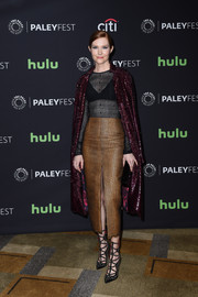 Darby Stanchfield teamed her top with a stylish tan leather skirt.