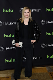 Abigail Breslin topped off her jumpsuit with a cropped jacket with dotted sleeves.