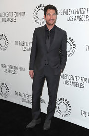 Dylan McDermott looked sleek in a charcoal suit at PaleyFest.