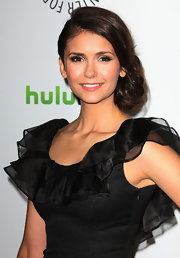 Nina Dobrev attended PaleyFest 2012 wearing her hair in a side-swept updo.