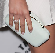 Olivia Munn carried a funky hard case clutch with dotted design and horn-shaped handle while attending the PaleyFest.