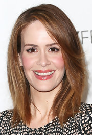 Sarah Paulson paired a subtle pink lip gloss with rosy cheeks for a super feminine and fun beauty look.