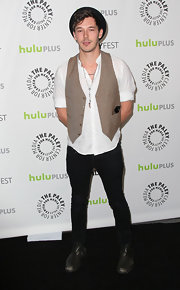 Sam Palladio played up the rocker look with a loose tan vest paired over a classic white tee.