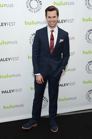 Andrew Rannells looked stylish and sophisticated in a blue suit with a funky red tie.
